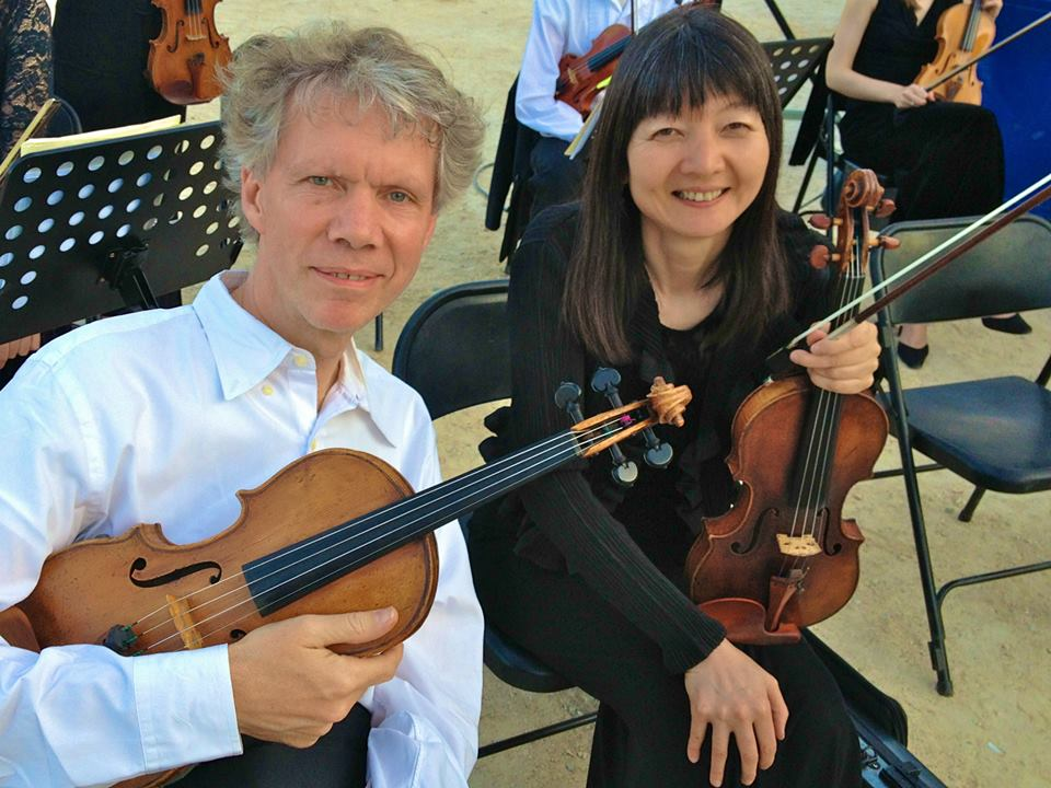 Concert master Mathias Tacke and Rika Seko preparing to play in Bandol, France on June 21. By Aurelien Petillot.