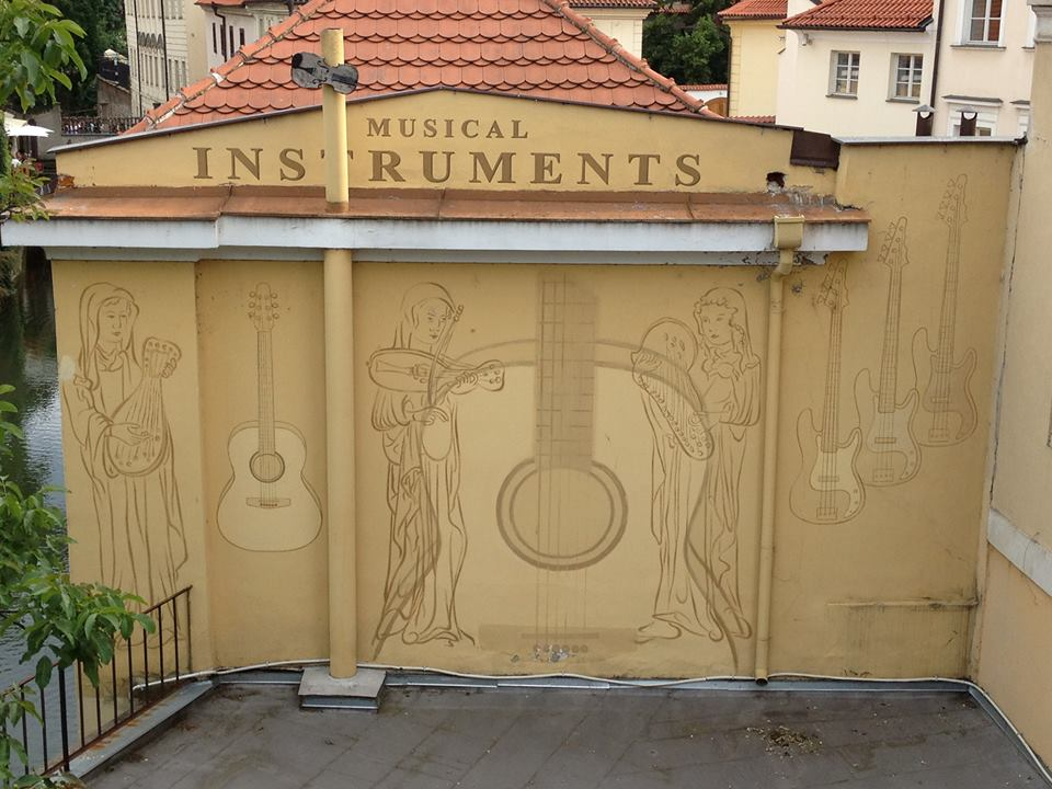 Wall engraving of musical instruments in Prague. By Aurelien Petillot.